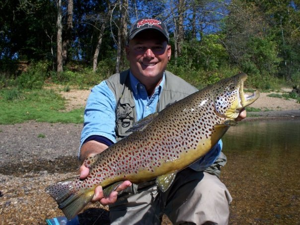A fly fisherman with a monster trout